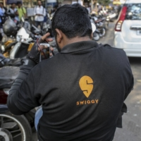 SoftBank Group Corp. is investing in Indian food delivery startup Swiggy as global investors see growing opportunity in the country's startup scene. | BLOOMBERG