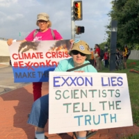 Demonstrators protest Exxon's climate change policies in Dallas in 2019.  | REUTERS
