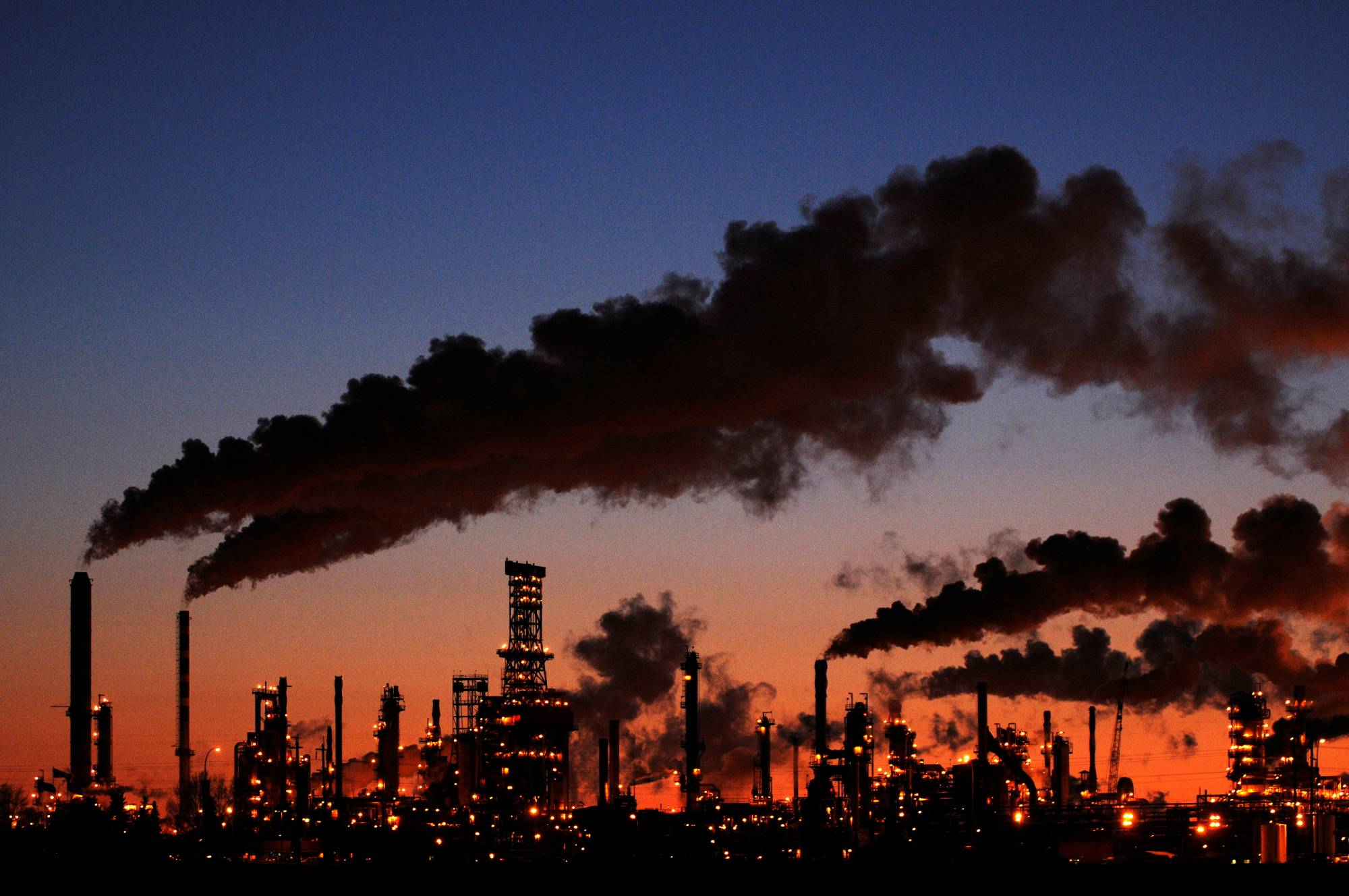 A refinery in Edmonton, Alberta. The 2015 Paris Agreement on climate change, signed by virtually all the world's nations, calls for capping global warming at