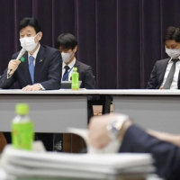 Yasutoshi Nishimura, the minister in charge of coronavirus response, speaks during a meeting of the government's virus subcommittee in Tokyo on Friday. | KYODO