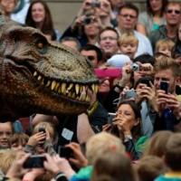 Visitors photograph an animatronic Tyrannosaurus rex at the reopening of the National Museum of Scotland in Edinburgh in July 2011.  | REUTERS