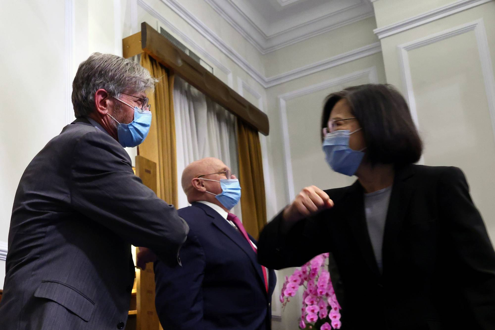 Taiwan President Tsai Ing-wen greets former U.S. Deputy Secretary of State Jim Steinberg at a meeting at the presidential office in Taipei on Thursday. | POOL / VIA REUTERS