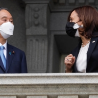 U.S. Vice President Kamala Harris and Prime Minister Yoshihide Suga talk as Harris welcomes Suga to her office in the Eisenhower Executive Office Building in Washington on Friday. | REUTERS
