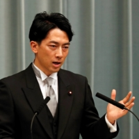 Environment Minister Shinjiro Koizumi speaks at a news conference in Tokyo in September.  | REUTERS
