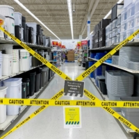An aisle of nonessential goods is cordoned off at a Walmart store in Toronto.  | REUTERS