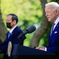 U.S. President Joe Biden speaks alongside Prime Minister Yoshihide Suga during a joint news conference at the White House on Friday.  | REUTERS