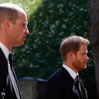 Prince William and Prince Harry follow the coffin during the funeral procession of Britain's Prince Philip to St. George's Chapel in Windsor Castle, in Windsor, west of London, on Saturday.  | AFP-JIJI