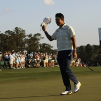 Hideki Matsuyama celebrates on the 18th green after winning the Masters in Augusta, Georgia, on April 11. | REUTERS