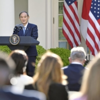 Prime Minister Yoshihide Suga speaks during a joint news conference with U.S. President Joe Biden at the White House in Washington on Friday. | KYODO