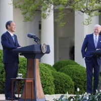 Prime Minister Yoshihide Suga speaks alongside U.S. President Joe Biden as they hold a joint news conference in the Rose Garden of the White House in Washington on Friday. | PRIME MINISTER'S OFFICE / VIA KYODO