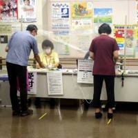 People arrive for cancer screening appointments at a public health center in Tochigi Prefecture in August 2020.   KYODO