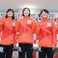 Rikako Ikee (center) and fellow Nihon University swimmers chosen for Japan's Olympic team pose during a sendoff ceremony on Saturday in Tokyo's Setagaya Ward. | HANDOUT / VIA KYODO