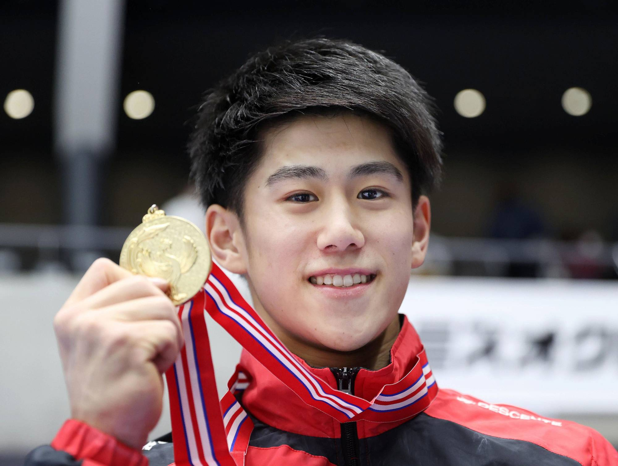 Daiki Hashimoto poses with his medal after winning the men's all-around competition at the national artistic gymnastic championships on Sunday in Takasaki, Gunma Prefecture. | HANDOUT / VIA REUTERS