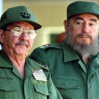 Raul and Fidel Castro preside over a ceremony marking the 100th anniversary of the death of independence hero Antonio Maceo, in Havana in December 1996.   | REUTERS