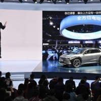Toyota Motor Corp. unveils a new electric vehicle at the Shanghai auto show on Monday. | KYODO