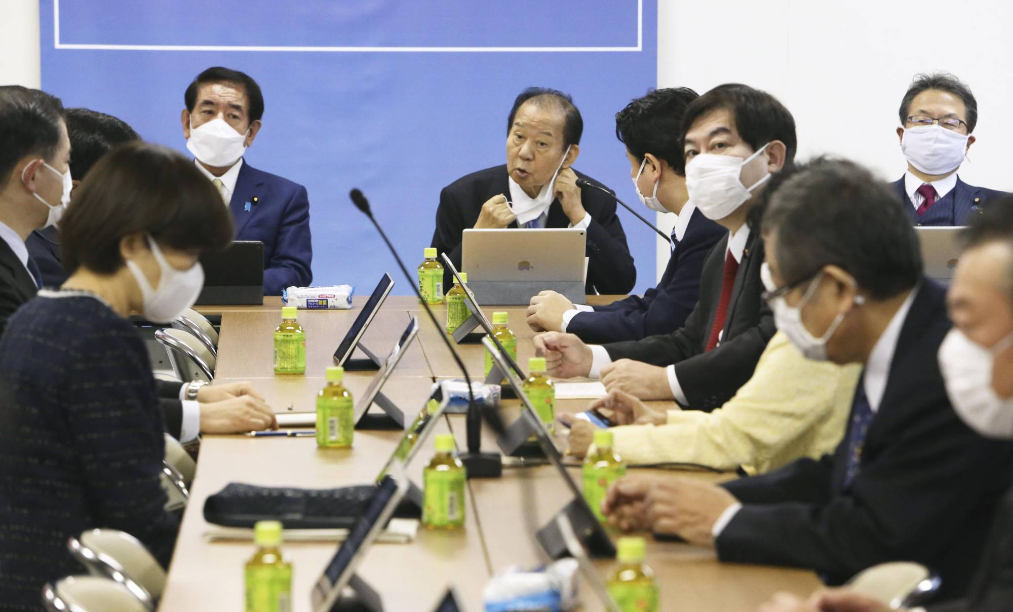 Liberal Democratic Party Secretary-General Toshihiro Nikai (center) discusses the proposed Children's Agency during a meeting at the LDP headquarters in Tokyo on April 13. | KYODO