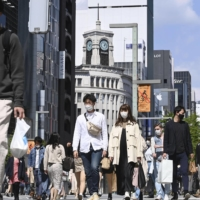 People walk in Tokyo's Ginza shopping district on April 11. | KYODO
