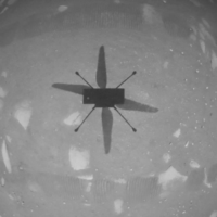 NASA's Ingenuity helicopter records its own shadow as it hovers over the Martian surface on Monday. | NASA / JPL-CALTECH / AFP