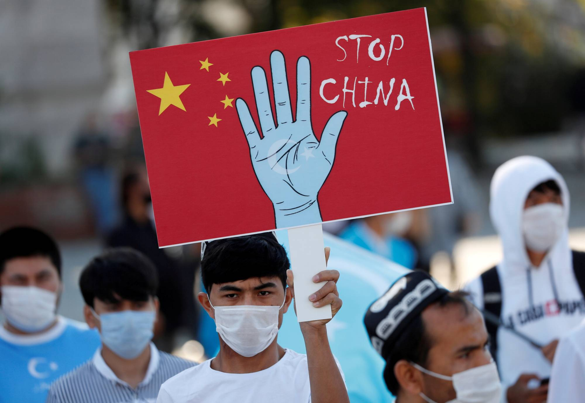 Ethnic Uyghur demonstrators take part in a protest against China, in Istanbul in October 2020.  | REUTERS