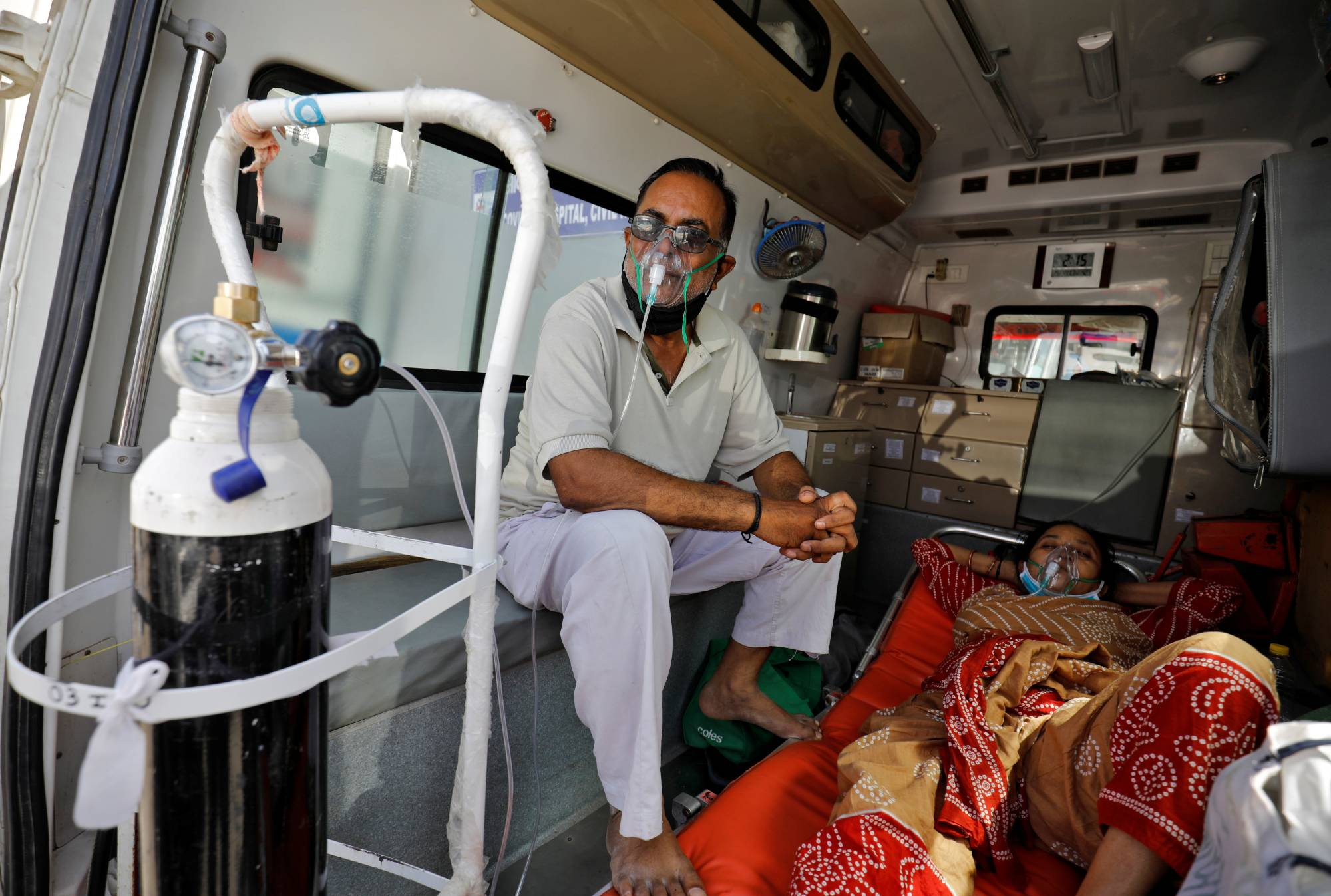Patients in an ambulance wait to enter a COVID-19 hospital for treatment in Ahmedabad, India, on Monday.    REUTERS