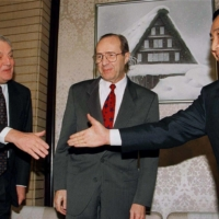 Prime Minister Ryutaro Hashimoto (right) extends his hand to Ambassador to Japan Walter Mondale (left) at the Prime Minister's Office in Tokyo as U.S. Defense Secretary William Perry looks on in December 1996. | REUTERS
