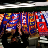 Barcelona, Atletico and Real Madrid scarves are displayed inside a store in Barcelona on Monday. | REUTERS
