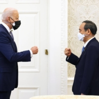Prime Minister Yoshihide Suga bumps fists with U.S. President Joe Biden ahead of their summit meeting at the White House in Washington on Friday. | PRIME MINISTER'S OFFICE TWITTER / VIA KYODO