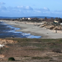A camp site on a beach that has shrunk because of coastal erosion, in Vias | AFP-JIJI