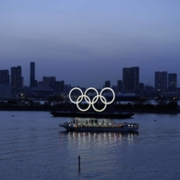 Japan should consider scrapping the Tokyo Olympics, an opposition lawmaker says. | BLOOMBERG