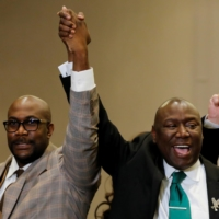 Floyd family attorney Ben Crump (right) and Philonise Floyd, brother of the late George Floyd, raise their fists during a news conference following the verdict in the trial of former Minneapolis police officer Derek Chauvin in Minneapolis on Tuesday.   REUTERS