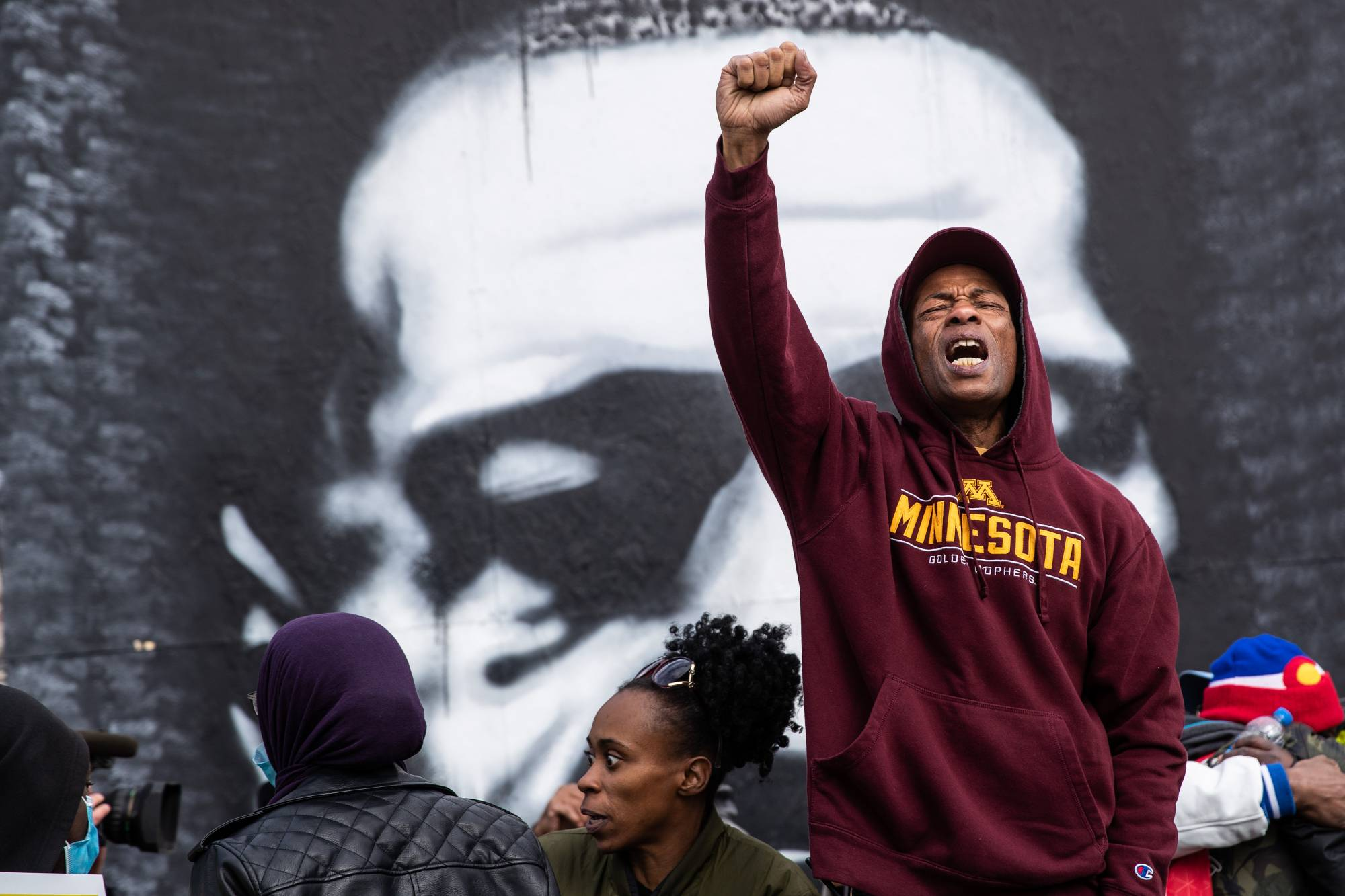 Leon Lyons, 60, celebrates the guilty verdict in the trial of Derek Chauvin for the murder of George Floyd, at George Floyd Square in Minneapolis on Tuesday.    VICTOR J. BLUE/THE NEW YORK TIMES