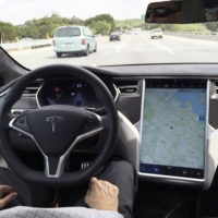 The interior of a Tesla Model S is shown in autopilot mode in San Francisco | REUTERS