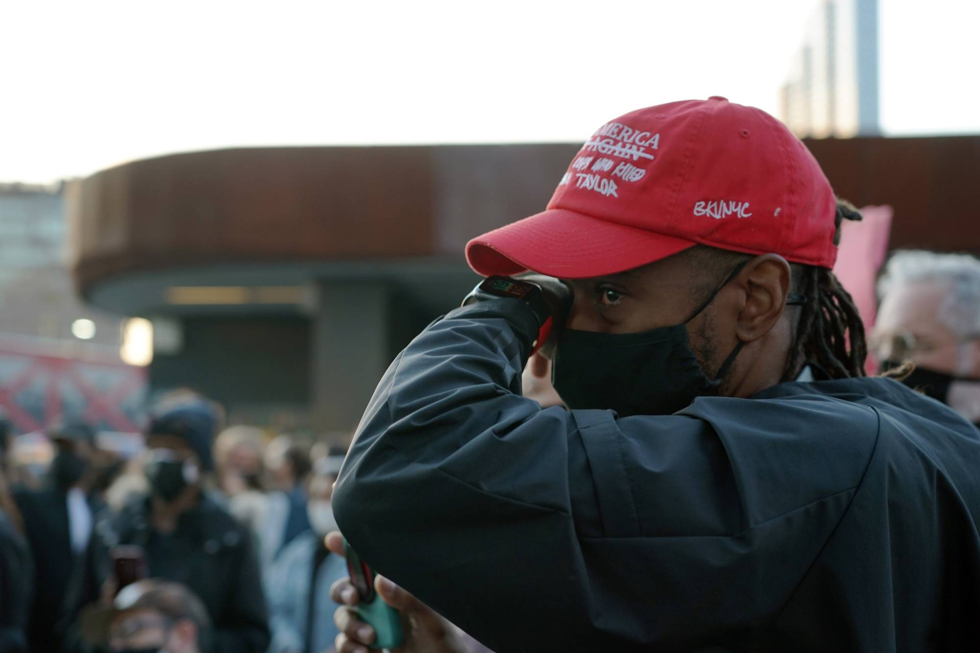 People gather outside the Barclays Center in Brooklyn, New York, on Tuesday to celebrate the guilty verdict in the George Floyd case. | MICHELLE V. AGINS / THE NEW YORK TIMES