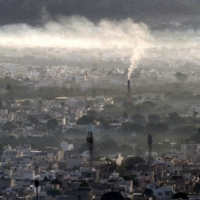 Smoke billows from a factory chimney during a smoggy morning in Ajmer, northern India. | AFP-JIJI