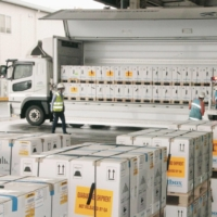 Cargo containing Pfizer Inc.'s COVID-19 vaccine is loaded onto a truck at Narita Airport in Chiba Prefecture on April 5, after its arrival from Belgium. | KYODO