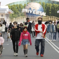 Critics say that calling for the closure of department stores and theme parks — where few cluster infections of the coronavirus have been reported, if any — is unscientific and merely symbolic. | KYODO