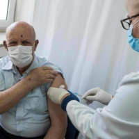 A man receives a dose of the AstraZeneca vaccine in Skopje, North Macedonia, in March. | AFP-JIJI