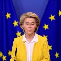 European Commission President Ursula von der Leyen speaks about the EU's COVID-19 vaccine strategy in Brussels on April 14. | POOL / VIA REUTERS