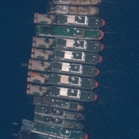 Last month, a group of 220 Chinese fishing boats was spotted in the South China Sea at Whitsun Reef, which is effectively controlled by the Philippines. | SATELLITE IMAGE ©2021 MAXAR TECHNOLOGIES / VIA REUTERS