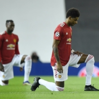 Manchester United's Marcus Rashford takes a knee before a Champions League match against Istanbul Basaksehir in Manchester, England, on Nov. 24, 2020. | REUTERS