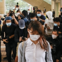 Pro-democracy activist Agnes Chow arrives at the West Kowloon Magistrates' Courts to face charges related to illegal assembly in Hong Kong in November. | REUTERS