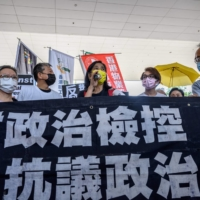 Pro-democracy activist Chan Po-ying speaks to the media with other fellow activists, including Cyd Ho (second from left) and Lee Cheuk-yan (third from left), outside the West Kowloon Court in Hong Kong on April 1.   | AFP-JIJI