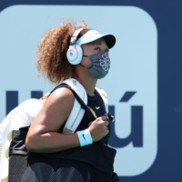 Naomi Osaka walks onto the court before her match against Maria Sakkari during the Miami Open on March 31. | USA TODAY / VIA REUTERS