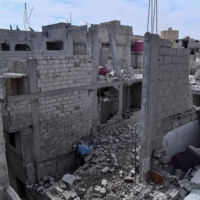 Damaged buildings are shown after what Syrian authorities said was an Israeli air strike in the western suburbs of Damascus, Syria, in this handout released in April 2020. | SANA / VIA REUTERS