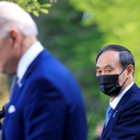 U.S. President Joe Biden holds a joint news conference with Prime Minister Yoshihide Suga at the White House on Friday. | REUTERS