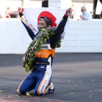 Takuma Sato celebrates after winning the Indianapolis 500 at Indianapolis Motor Speedway in Indianapolis on Aug. 23, 2020. | USA TODAY / VIA REUTERS