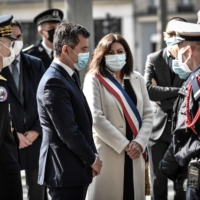 Paris Mayor Anne Hidalgo meets with family during a ceremony in tribute of a French policeman who was killed in 2017, in Paris on Tuesday. | AFP-JIJI