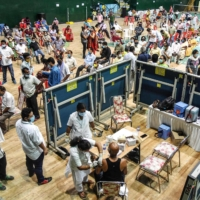 A COVID-19 vaccination site at an indoor stadium in Guwahati, India, on Thursday  | AFP-JIJI