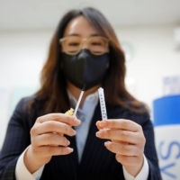 Cho Mi-heui, vice president of Poonglim Pharmatech Inc., showcases a sample of a low dead space syringe at a company office in Gunsan, South Korea. | REUTERS