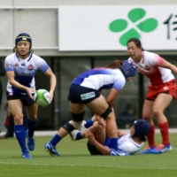 Rugby sevens players compete in an exhibition during an Olympic test event at Tokyo Stadium on Thursday. | KAZ NAGATSUKA